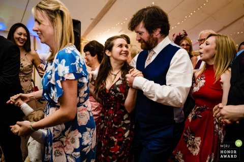 Eggington House wedding reportage photograph from the packed dance floor