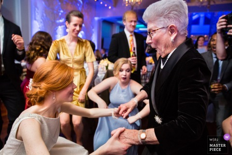Bride dances with mother at the wedding reception in Fox Hollow Long Island