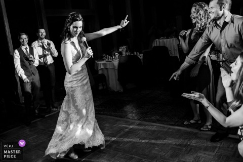 Guests smile as the bride sings and dances at the wedding reception at Lake Tahoe, Ca