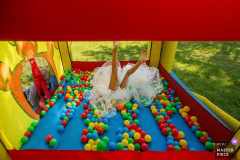 Bride in her wedding dress in a bouncy castle in Netherlands
