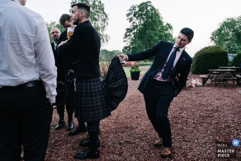 Best man messing with the grooms kilt at the wedding at the Colstoun House, Haddington