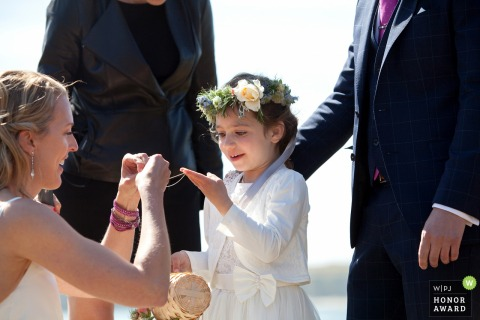 MacCallum House Inn, Mendocino, CA - a young girl takes part in the wedding ceremony outdoors - land trust ceremony gift