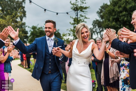 Bride and groom have an impromptu line of 120 high fives - private house wedding in the UK