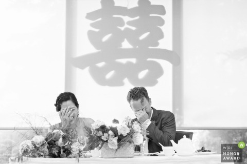 Hong Kong East Ocean - Emeryville, CA - the bride and groom cover their faces in embarrassment at the reception