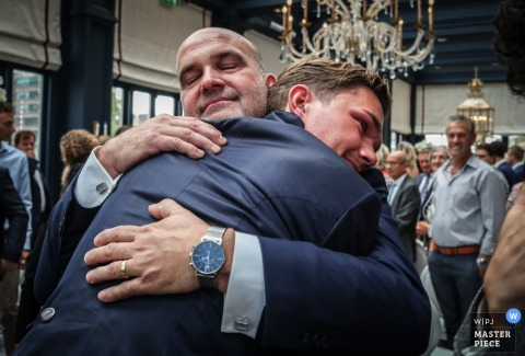 father and son hugging at wedding in Amsterdam