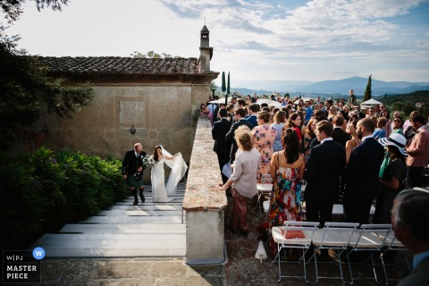 Guests prepare to greet the bride as they make their way upstairs in this photo by a Venice, Italy wedding photographer.