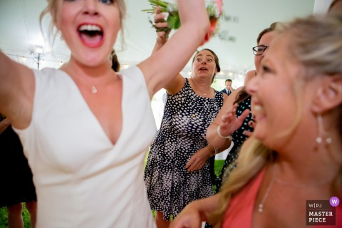 Ohio wedding photograph of the bouquet toss