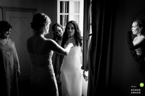 France bridesmaids admire the bride in her dress - Chateau Dumas weddings