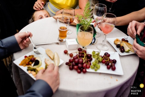 The guests enjoy appetizers in Barnard, VT by a Burlington wedding photographer.