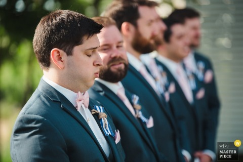 The groom takes a deep breath at the altar in Stevensville, MD by a Washington, D.C. wedding photographer.