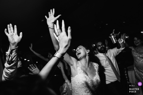 Black and white photo of the bride dancing with her guests in Purcellville, VA by a Washington, D.C. wedding photographer.