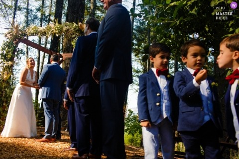 N. CA outdoor wedding ceremony in the trees with kids.