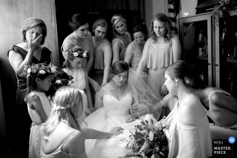Tennessee wedding photo of bride being prayed over by family and friends.