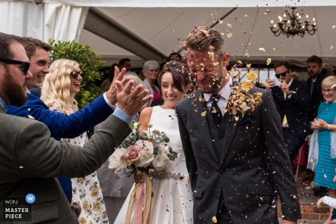 Bride and groom, confetti photograph, Odo's Barn wedding, Kent