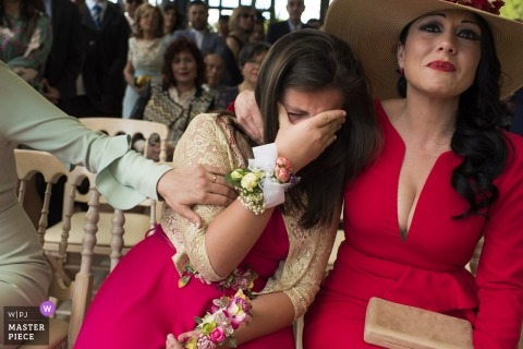 Valencia wedding picture of women crying in the front row of the ceremony.