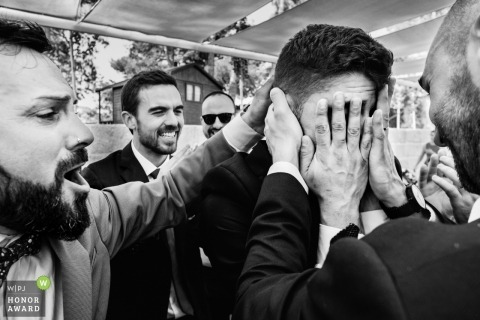 Groom tries not to cry around the groomsmen at his Alcoy wedding