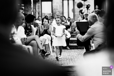 Agen, France wedding picture of the flower girl walking into the ceremony.