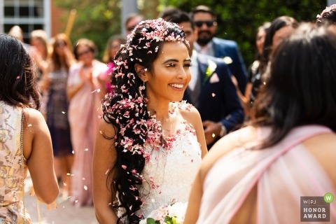 Lazio Bride gets flowers and confetti all over her hair and lashes after the ceremony