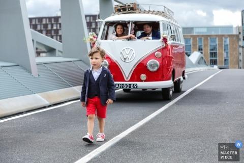 wedding kid on the bridge with a vintage VW van in Amsterdam