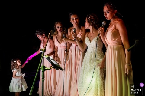 kyrenia cyprus wedding reception | bride is singing with the bridemaids