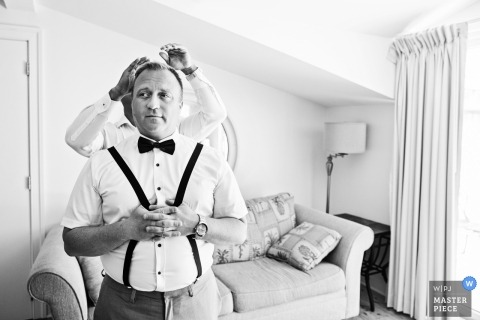 groomsmen has help with his hair | grand hotel cape may wedding