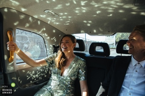 Women's dress reflects light all over the car in London