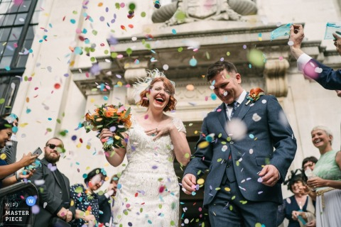 Bride and Groom with confetti outside of Islington Town Hall London