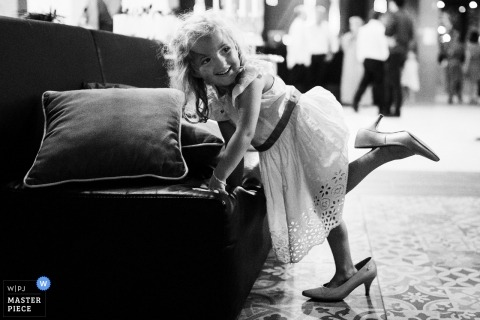 Braga Wedding Photojournalism | a young girl plays in women's high-heeled shoes
