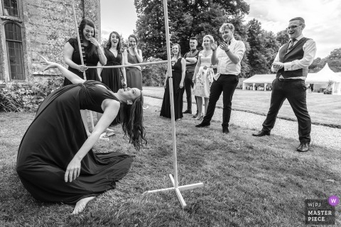 Mapperton House Wedding Photographer | outdoor at limbo shot with guests having fun.