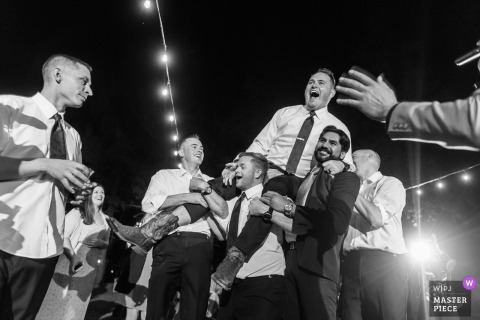 Truckee, CA Wedding Photojournalism | the boys get crazy on the reception dance floor