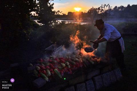 Kennebunkport, Maine Wedding Photojournalism | outdoor wedding reception food preparation on open fire