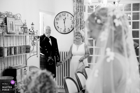 France Wedding Photojournalism | mother and father react to seeing the bride in her dress for the first time