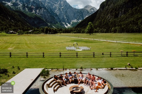 Slovenia wedding guests linger in the picturesque setting for a mountain wedding