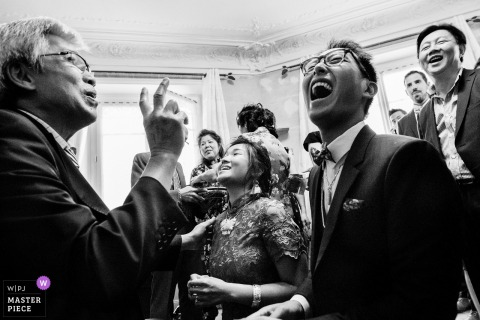 Paris Wedding Photojournalism | abundant laughter in this black-and-white reception photo