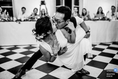 Paris Wedding Photojournalism | the bride is dipped on the dance floor by the groom