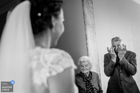 Velsen Zuid Wedding Photojournalism | the first look of the bride in her dress can bring tears