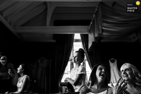Lancashire Wedding Photojournalism | the women are having a good time at the indoor reception
