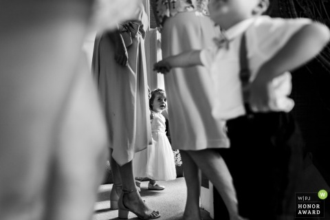 Lancashire flower girl watches the adults get dressed for the wedding ceremony