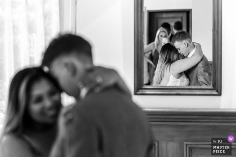 France Wedding Photojournalism | dancing reception couple reflected in a wall mirror