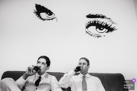 Umbria, Italy Wedding Photojournalist | someone is watching synchronized reception drinkers