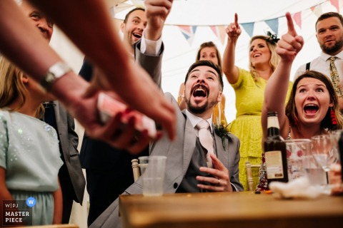 London Wedding Photojournalist | magician entertains wedding guests at the reception
