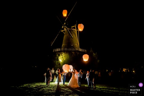 Zuid Holland Wedding Photojournalist | lanterns are released at night by the guests at this windmill reception