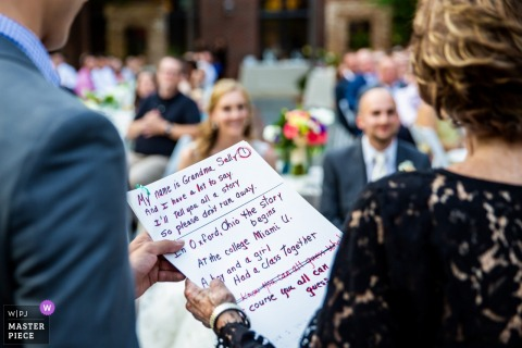 Winnetka, Illinois Wedding Photojournalist | mom reads from a note card during the outdoor wedding ceremony