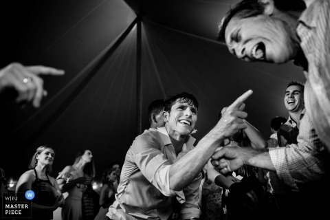Monkton, VT Wedding Photojournalist | the man take over the dance floor in this black and white reception Photo