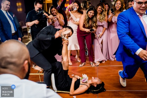 Washington DC Wedding Photojournalist | action packed reception dance floor with garter removal