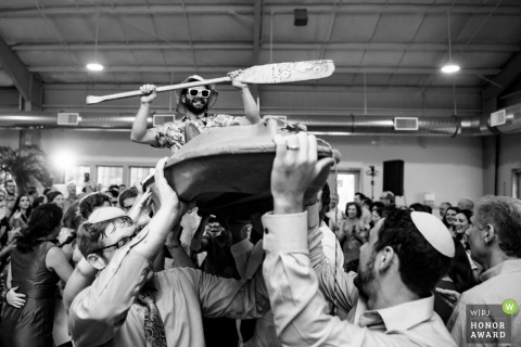 Palmer Massachusetts Wedding guest crowdsurfing in a kayak during hora