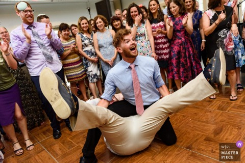 Wedding guests goofing off during the hora | Palmer, Massachusetts
