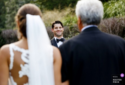 The groom locks eyes on his bride as her dad walks her down the aisle. | Armour House, Lake Forest, IL