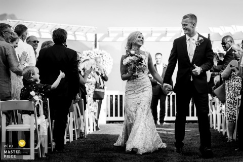 WA bride and groom walking out of the ceremony holding hands