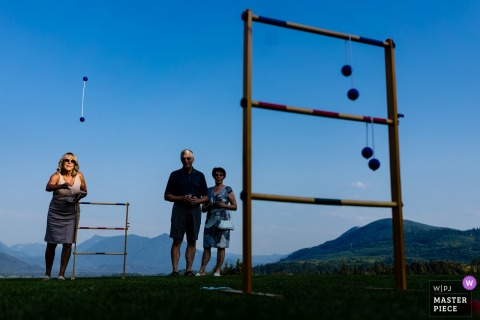 Snohomish, WA Wedding Photojournalist | outdoor reception with throwing skill games